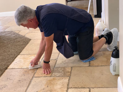 Owner of Big West Carpet Cleaning St George UT doing Tile and Grout Cleaning